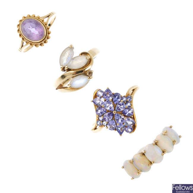 Four gem-set dress rings.