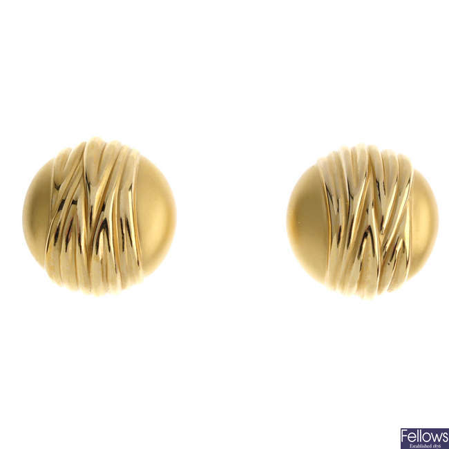A pair of 9ct gold earrings.