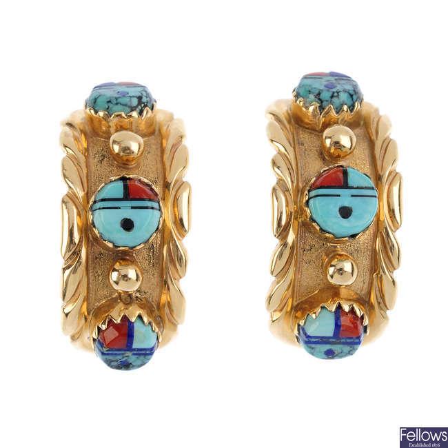 A pair of multi-gem earrings.