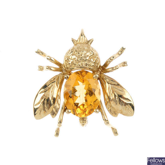 A citrine fly pendant.
