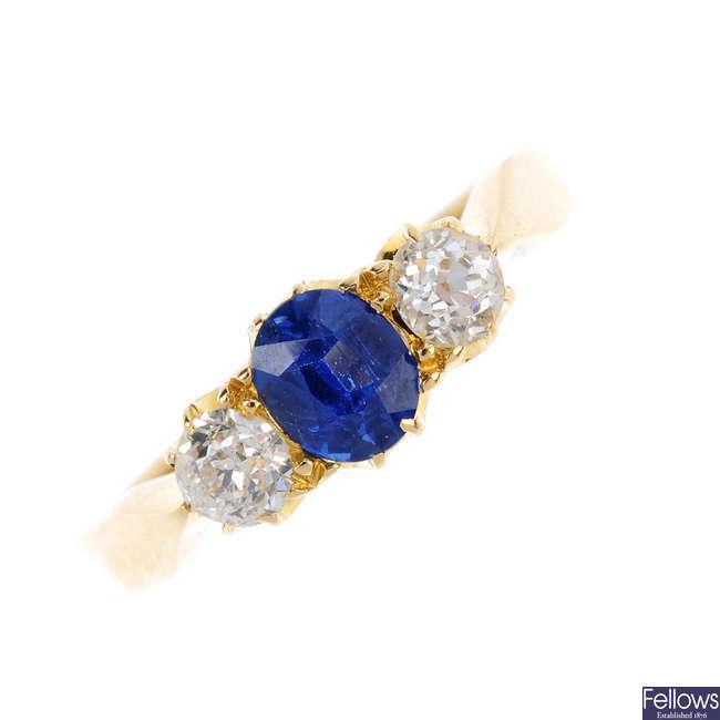 An Edwardian 18ct gold sapphire and diamond three stone ring.