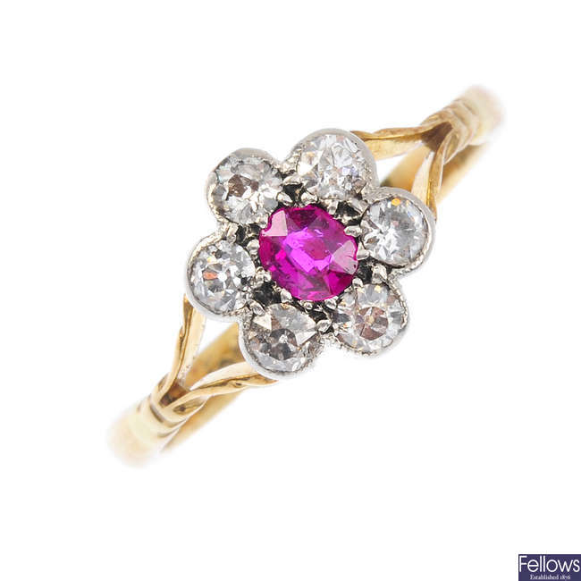An early 20th century 18ct gold ruby and diamond cluster ring.