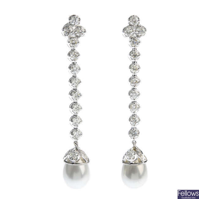 A pair of diamond and imitation pearl earrings.