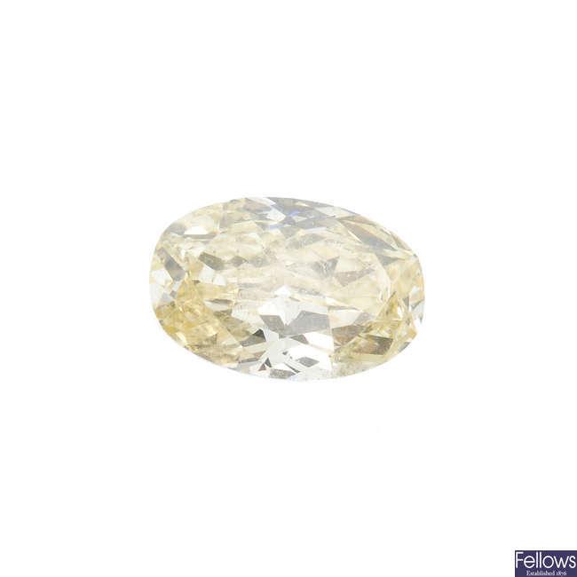 An oval-shape 'yellow' diamond, weighing 0.61ct.