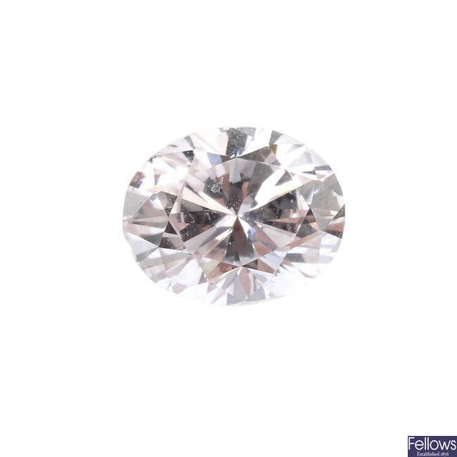 An oval-shape 'pink' diamond, weighing 0.54ct.