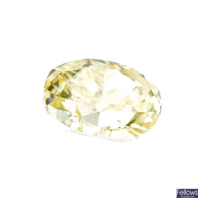 An oval-shape 'yellow' diamond, weighing 0.50ct.