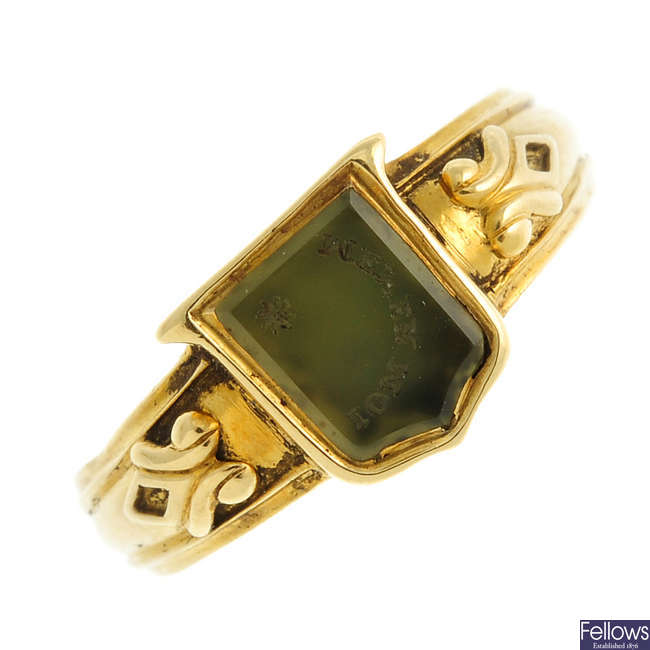 A late 19th century gold green hardstone intaglio ring.