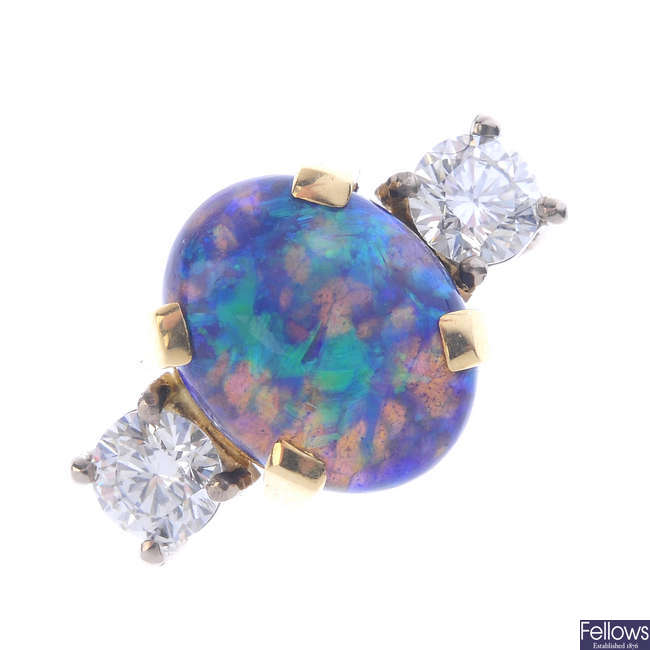 An 18ct gold opal and diamond three-stone ring.