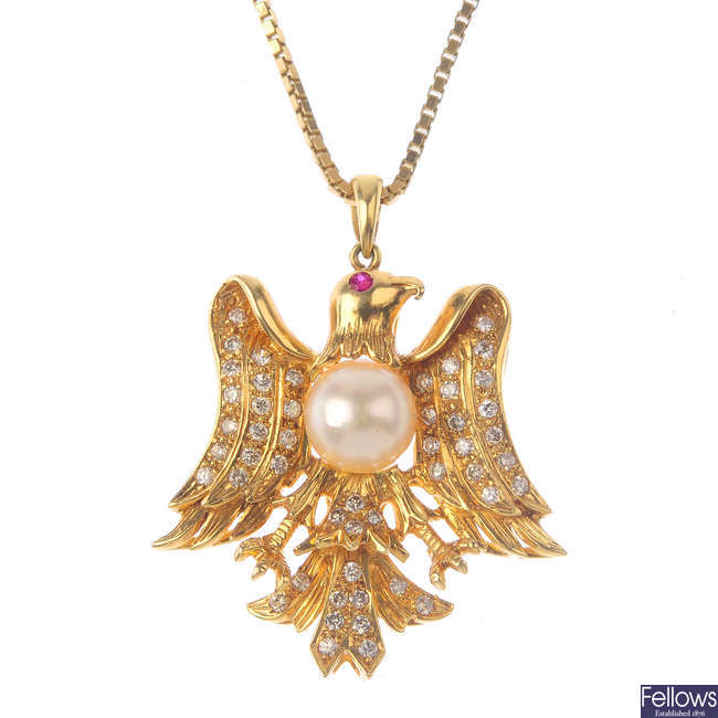 A cultured pearl and diamond eagle pendant, with chain.