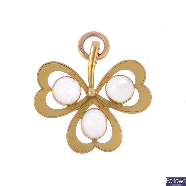 An early 20th century 15ct gold moonstone three-leaf clover pendant.