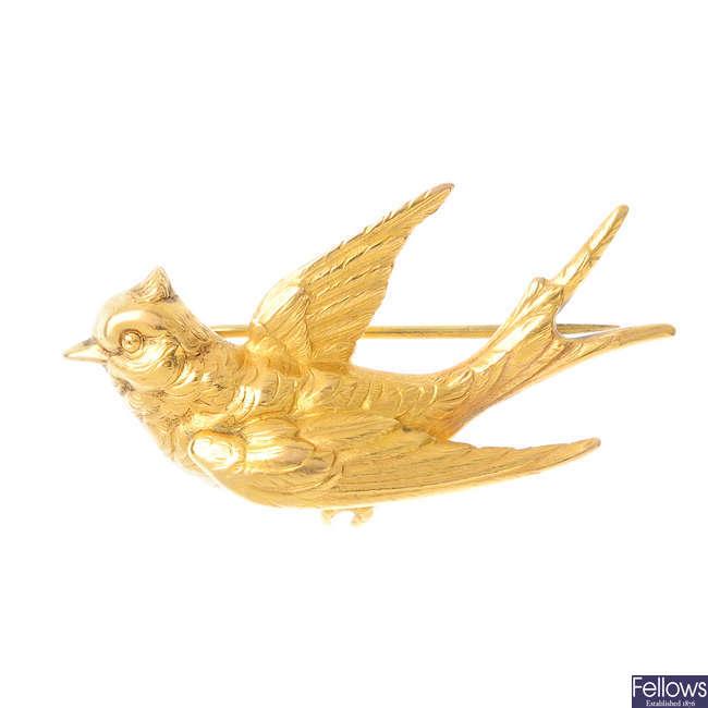 A swallow brooch.