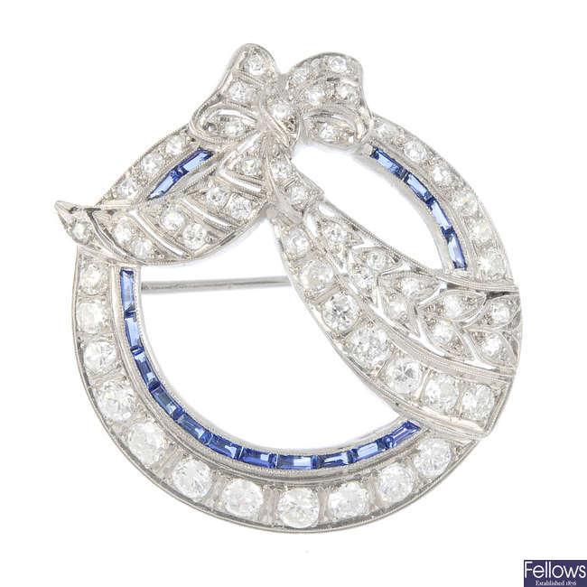 A mid 20th century diamond and sapphire brooch.