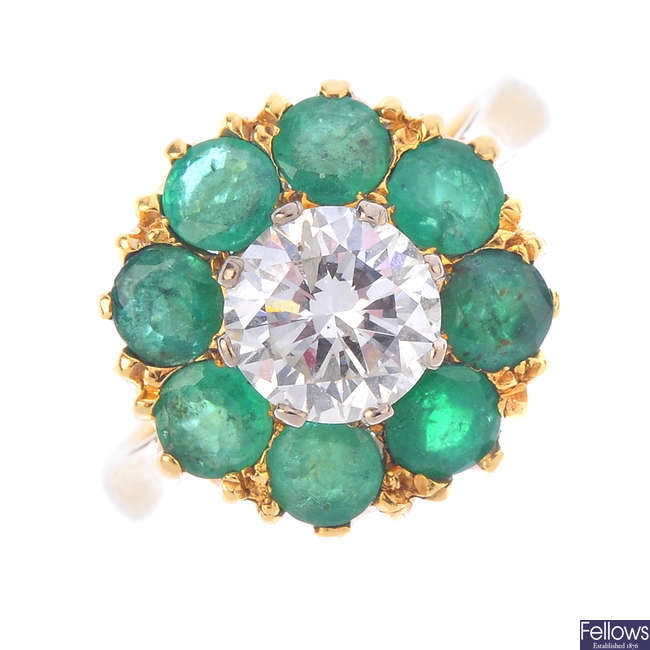 A diamond and emerald cluster ring.