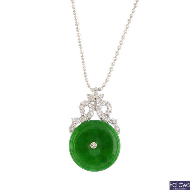A jade and diamond pendant, with chain.