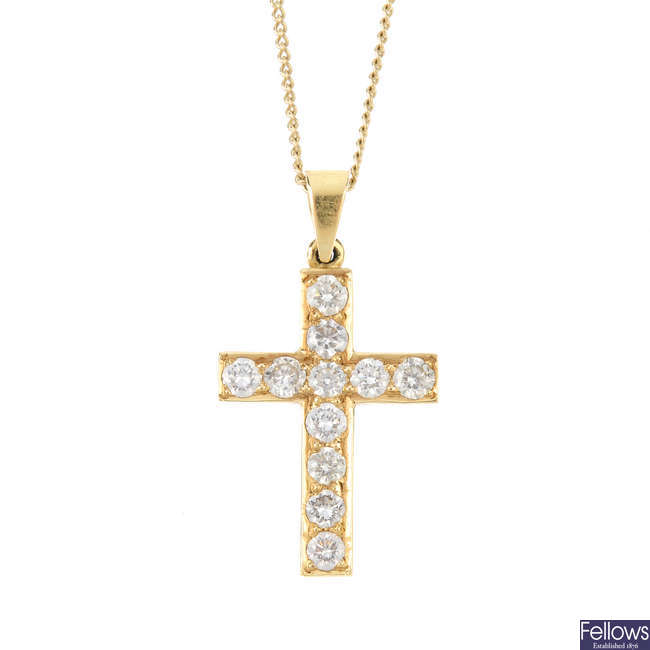 An 18ct gold diamond cross pendant, with 9ct gold chain.
