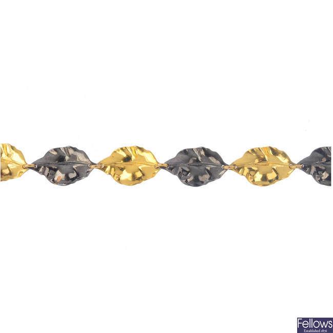A 9ct gold leaf bracelet.