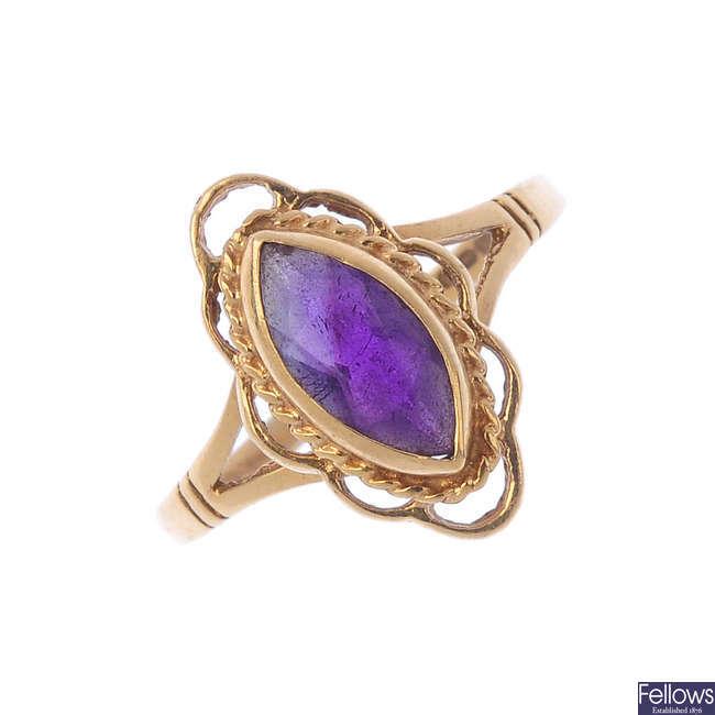 Four 9ct gold gem-set dress rings.