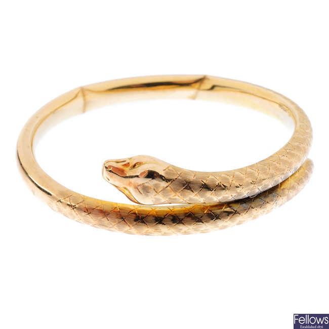 A 1920s 9ct gold snake bangle.