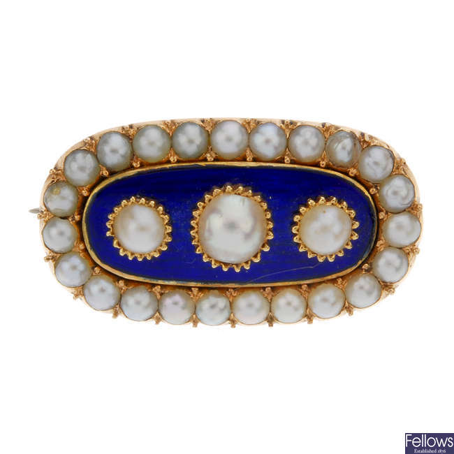 A late Victorian split pearl and blue enamel brooch.