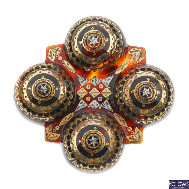 A late 19th century tortoiseshell pique brooch.