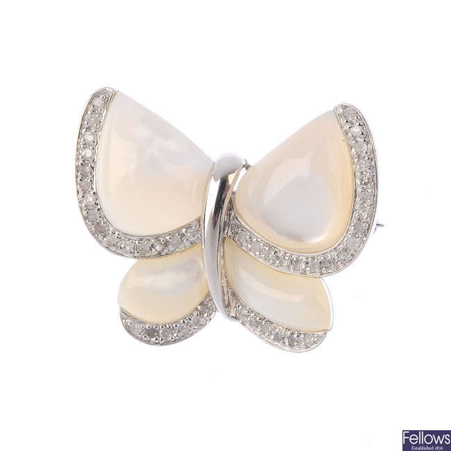 A mother-of-pearl and diamond butterfly brooch.