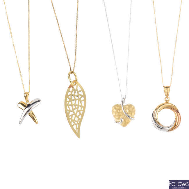 Four pendants, with chains and a pair of earrings.