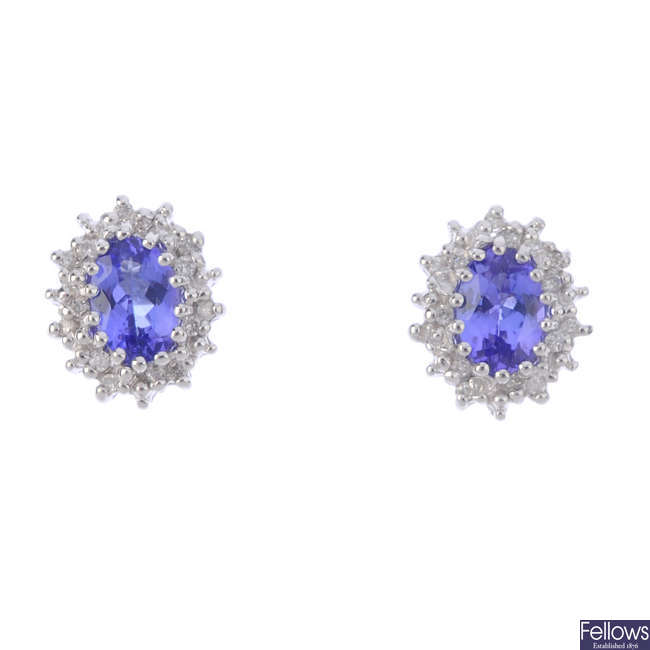 A pair of tanzanite and diamond cluster earrings.