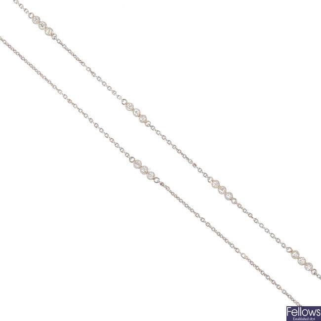 A diamond longuard necklace.