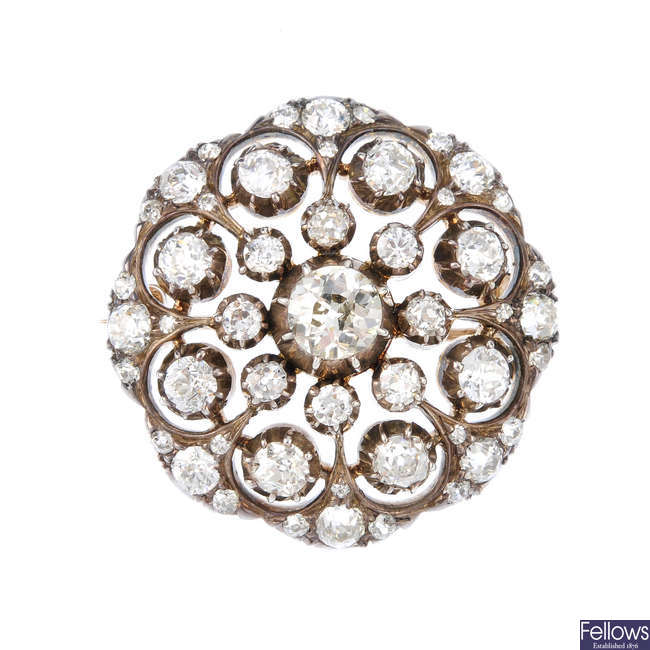 A late Victorian silver and gold diamond cluster brooch.