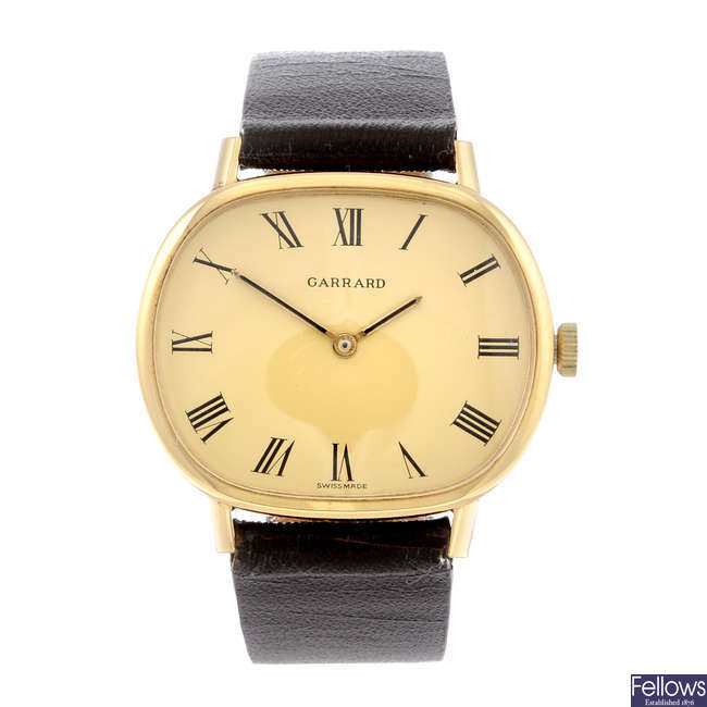 GARRARD - a gentleman's gold plated wrist watch together with a Lanco wrist watch.