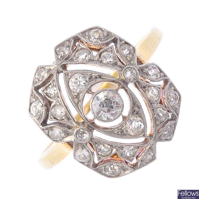 An Art Deco platinum and 18ct gold diamond ring.