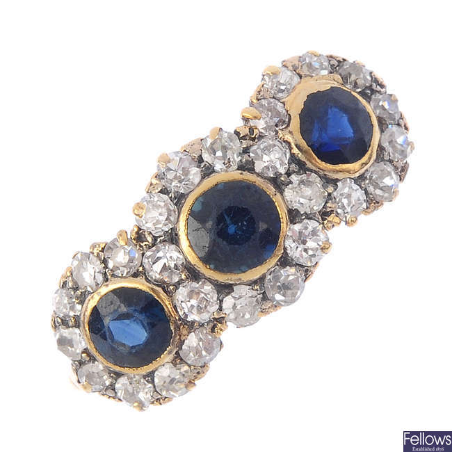 A mid 20th century 18ct gold sapphire and diamond triple cluster ring.