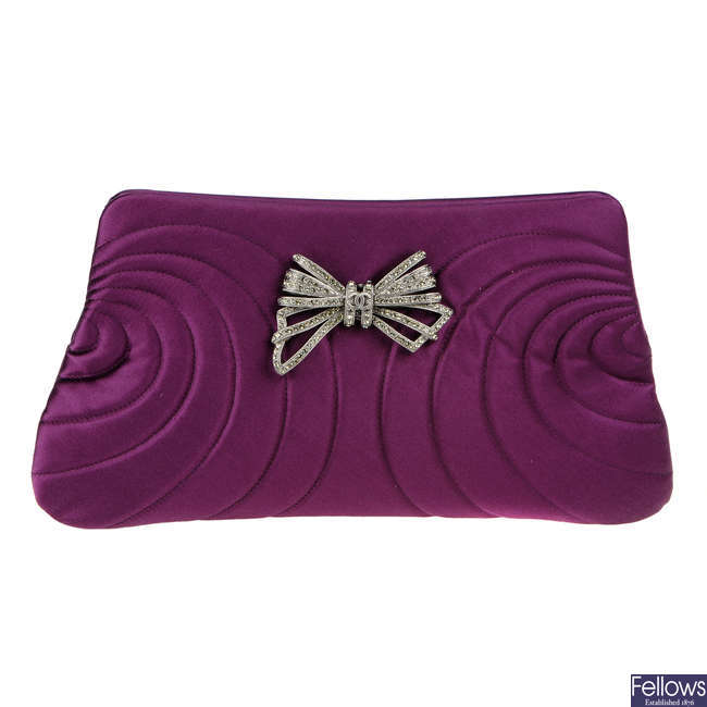 CHANEL - a purple satin clutch.