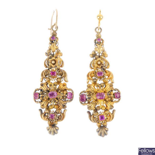 A pair of late Georgian gold foil-back ruby earrings.