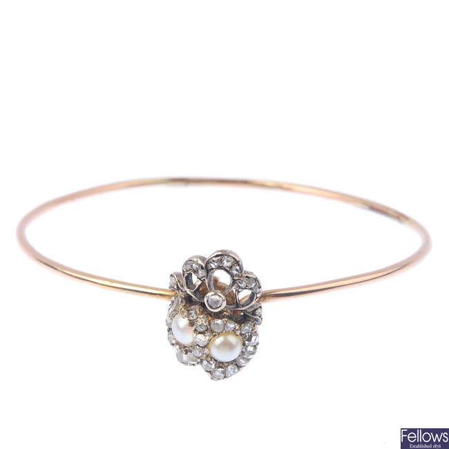 A split-pearl and diamond bangle.