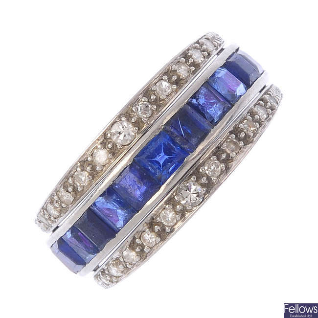 A sapphire, ruby and diamond flip ring.