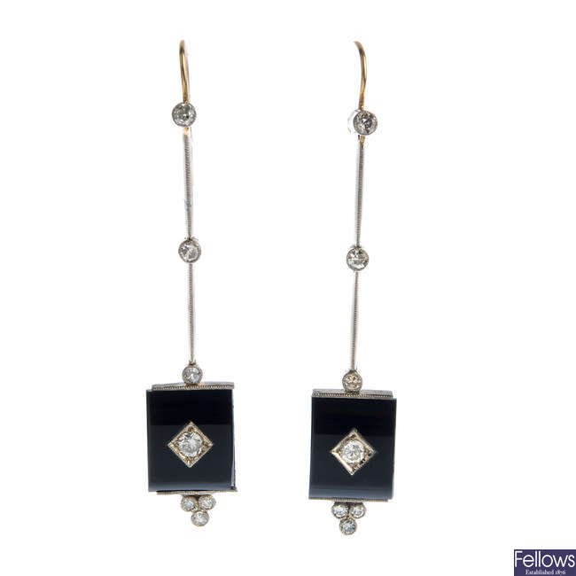 A pair of diamond and onyx earrings.