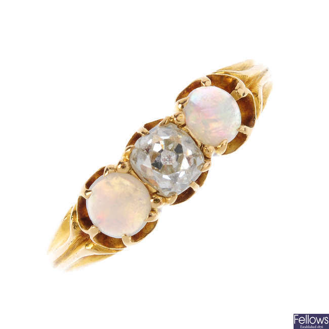 An early 20th century 18ct gold diamond and opal three-stone ring.