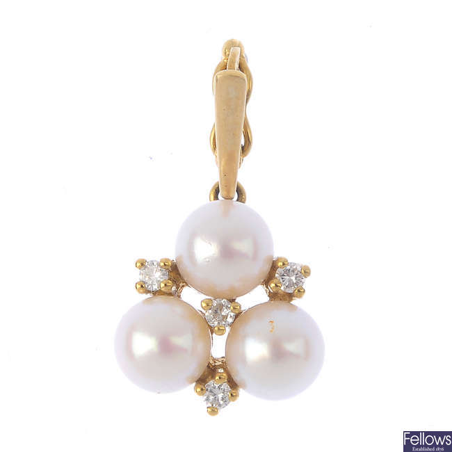 A 9ct gold cultured pearl and diamond pendant.