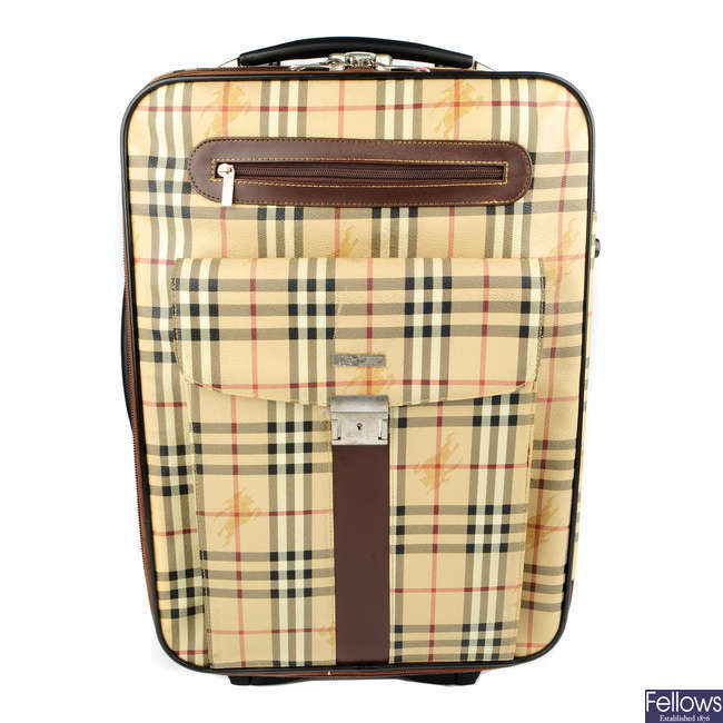BURBERRY - a rolling suitcase.