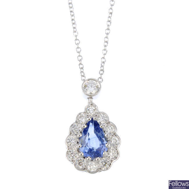 A sapphire and diamond pendant with chain.
