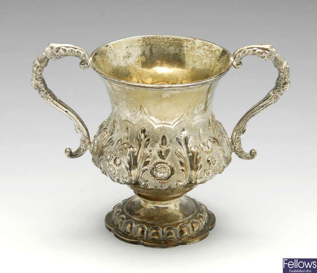 A William IV silver twin-handled cup & George III cream jug.