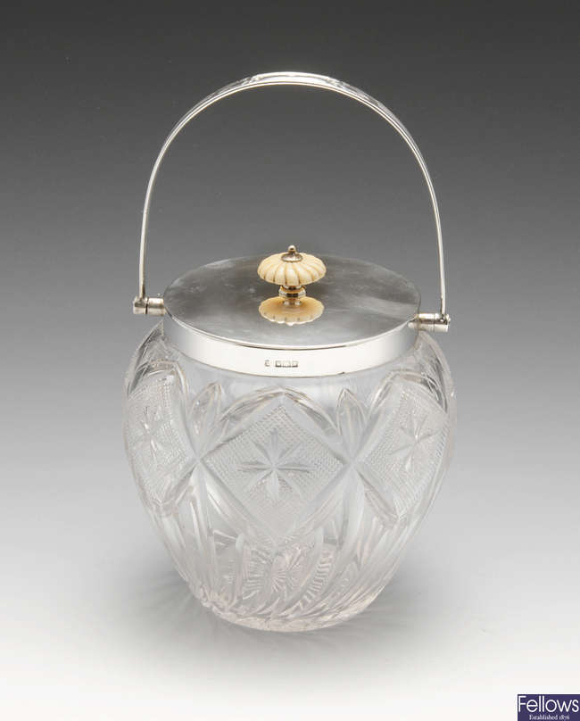 An Edwardian silver mounted cut-glass biscuit barrel.