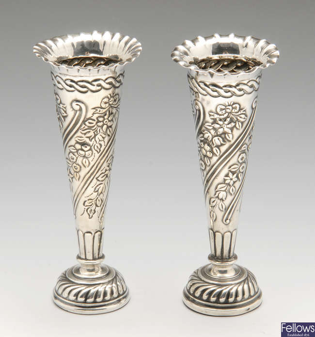 A pair of late Victorian embossed silver bud vases.