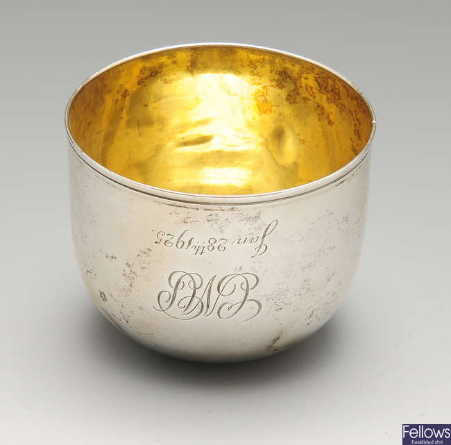 A George III silver tumbler cup of plain raised form.