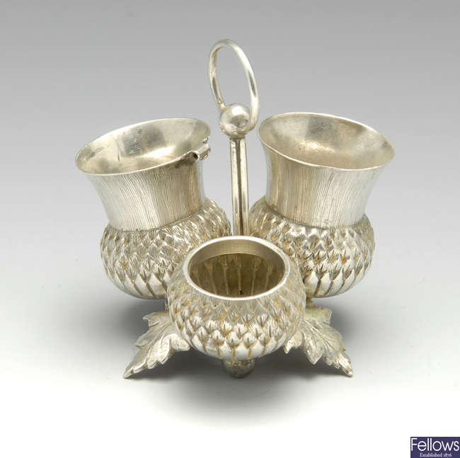 A Victorian novelty silver cruet modelled as a thistle.