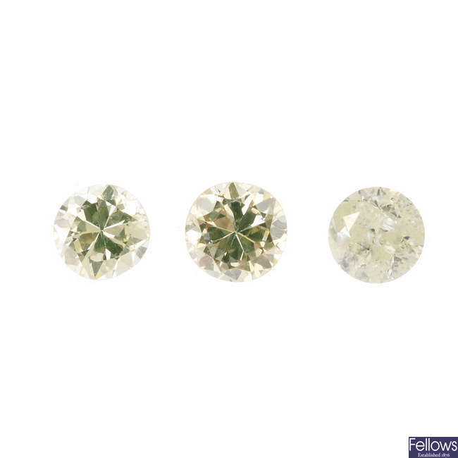 Three brilliant-cut diamonds, weighing 0.25, 0.25 and 0.24ct.