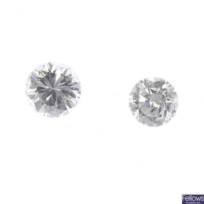 Two brilliant-cut diamonds, weighing 0.28 and 0.26ct.