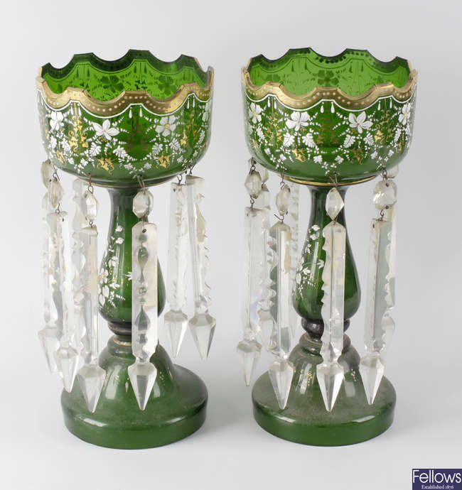 A pair of early 20th century green glass table lustres.