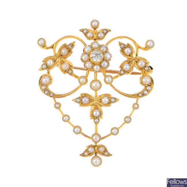An early 20th century 15ct gold diamond and split pearl brooch.
